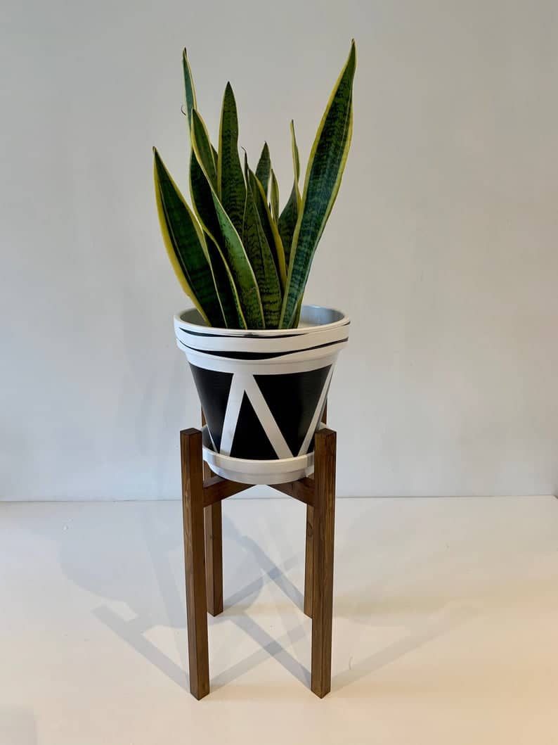 handmade dark wood plant stand. Click on the image to shop from Etsy maker.