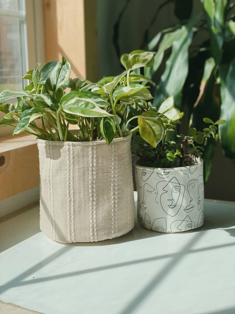 Hand-woven Ikat Planter in beige colour with white vertical lines. Click the image to shop the planter on Etsy