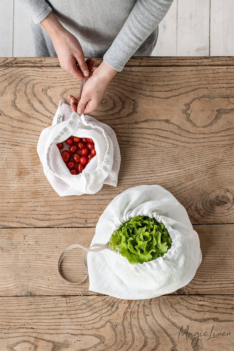 two natural white linen handmade produce bags. One with lettuce and the other with tomatoes. To shop click on the image and it will take you to Etsy shop called Magic linen