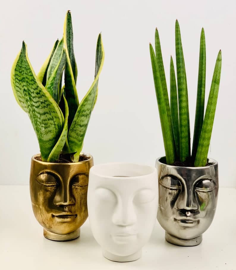 Three Face Silhouette ceramic planters in black, white and gold colour. Click on the image to shop from the Etsy Maker.