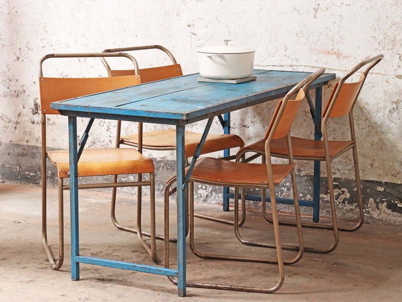 Outdoor vintage folding table in blue with four orange dining chairs