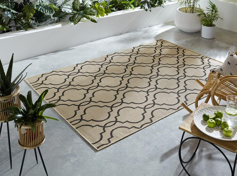 handmade outdoor rug in cream and black pattern