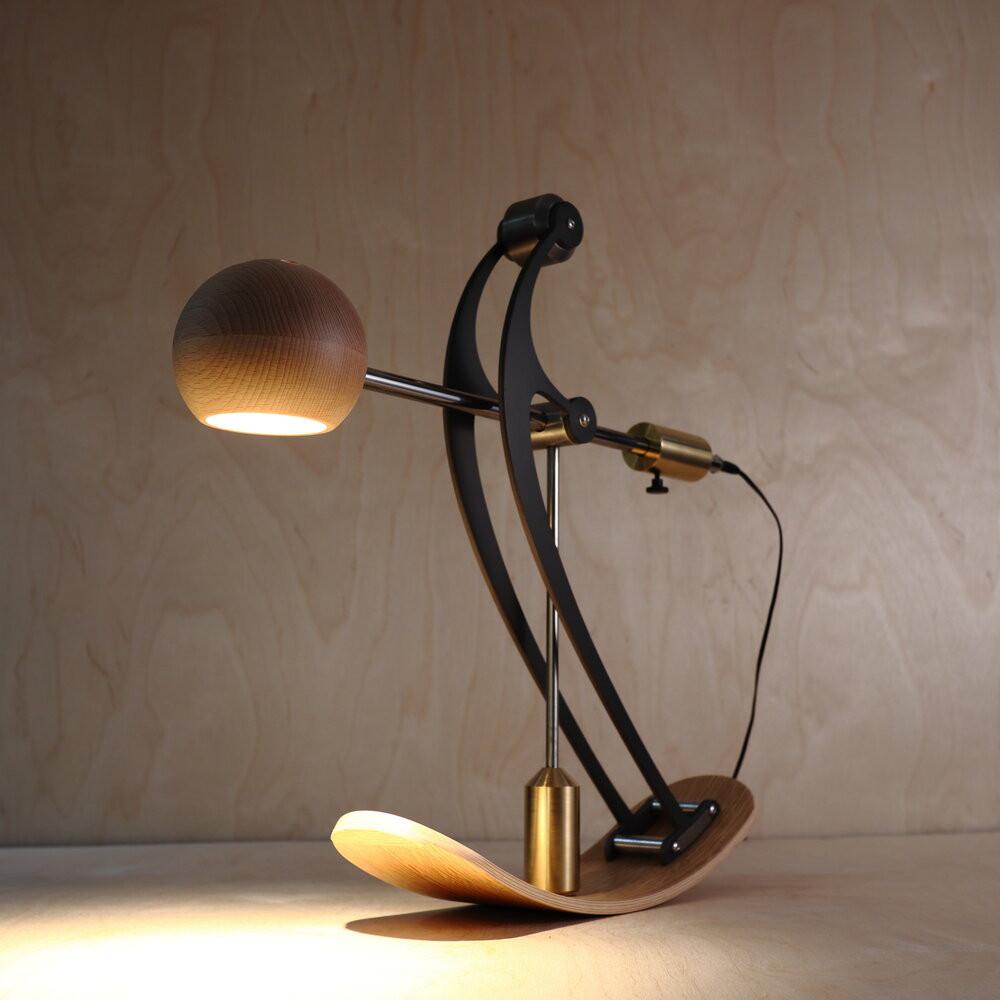 minimal balance desk lamp in black,  handmade from wood and steel.