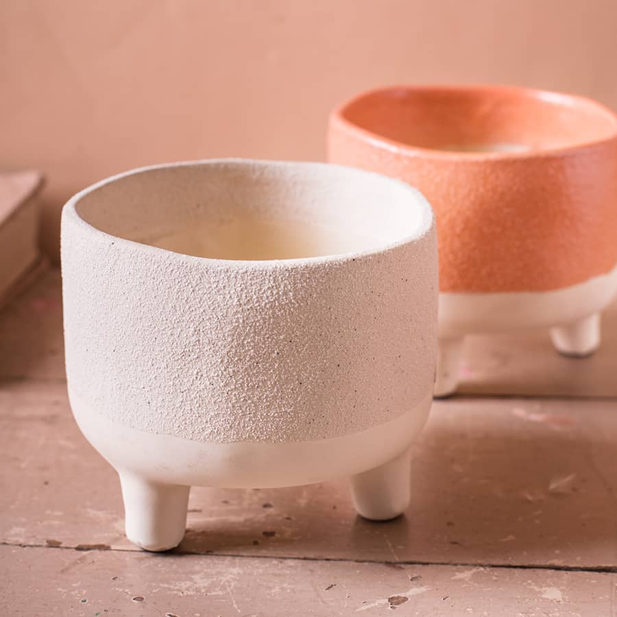 Earthenware planters in whit and peachy colours with short feet. Click on the image to shop at naturalcollection.com