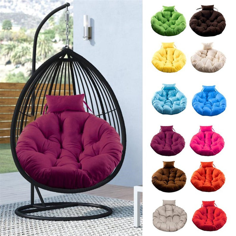 Outdoor hanging egg chair in black with pink seating cushion