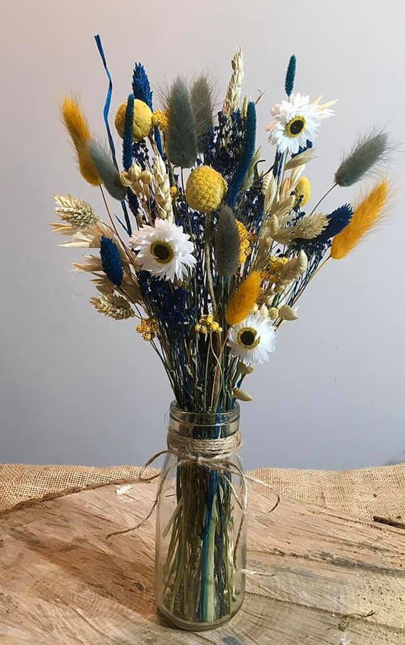 grey blue and mustard yellow dried flower arrangement