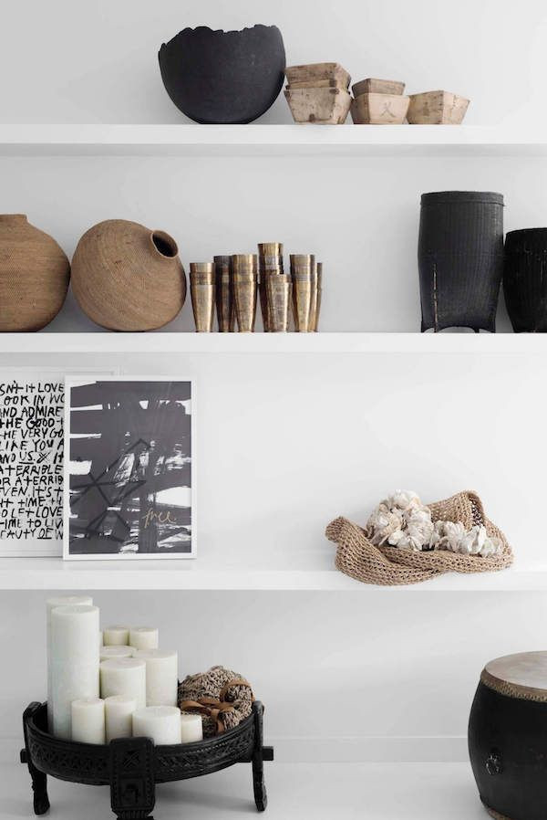 How to style a minimalist bookshelf with black gold and wooden details