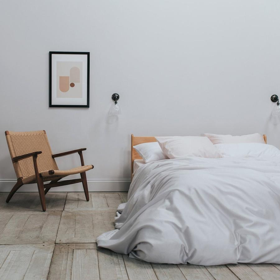 Ethical lux cotton bedding in white colour. click on the image to shop directly from the maker, Bedfolk.