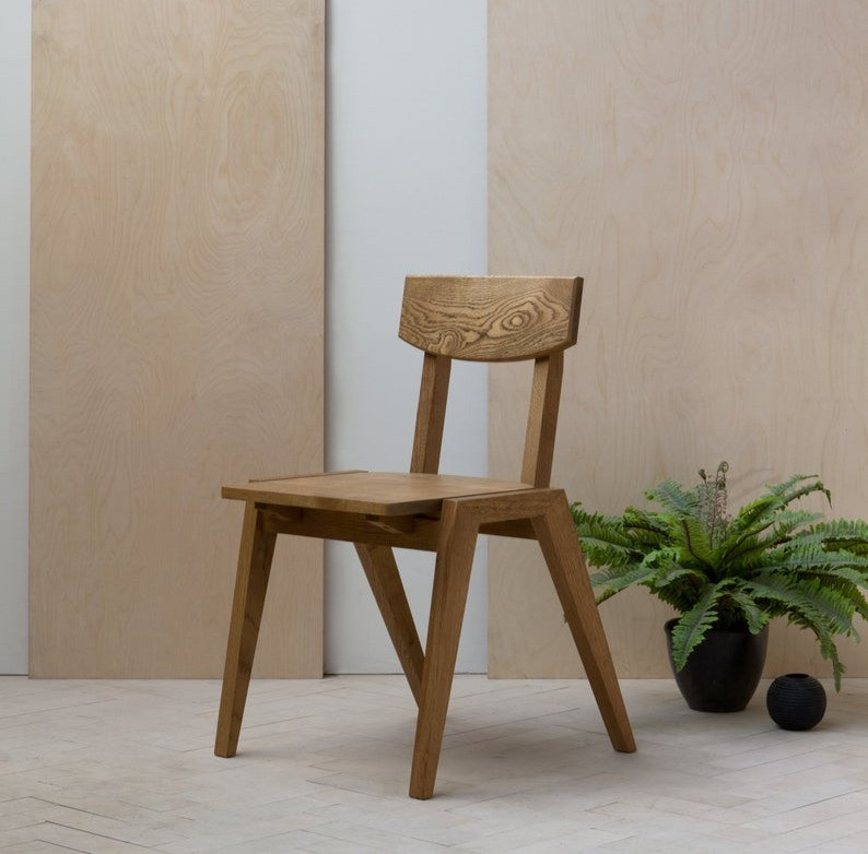 handmade sustainable oak dining chair in light wood colour, perfect for breakfast nook
