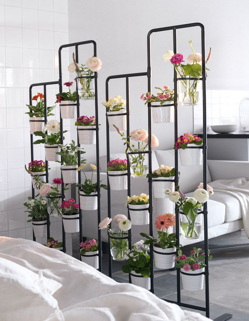 colourful plants used as a room divider on a frame made of pipes