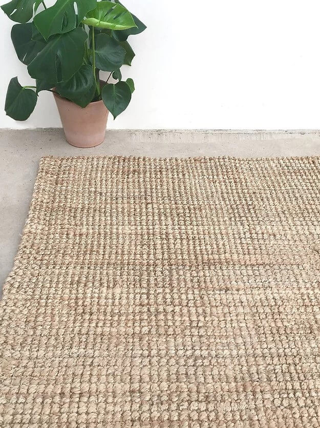 sustainable natural jute rug for an Eco-conscious breakfast nook decor