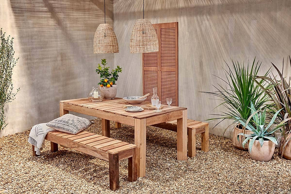 Outdoor dining table made from reclaimed teak wood