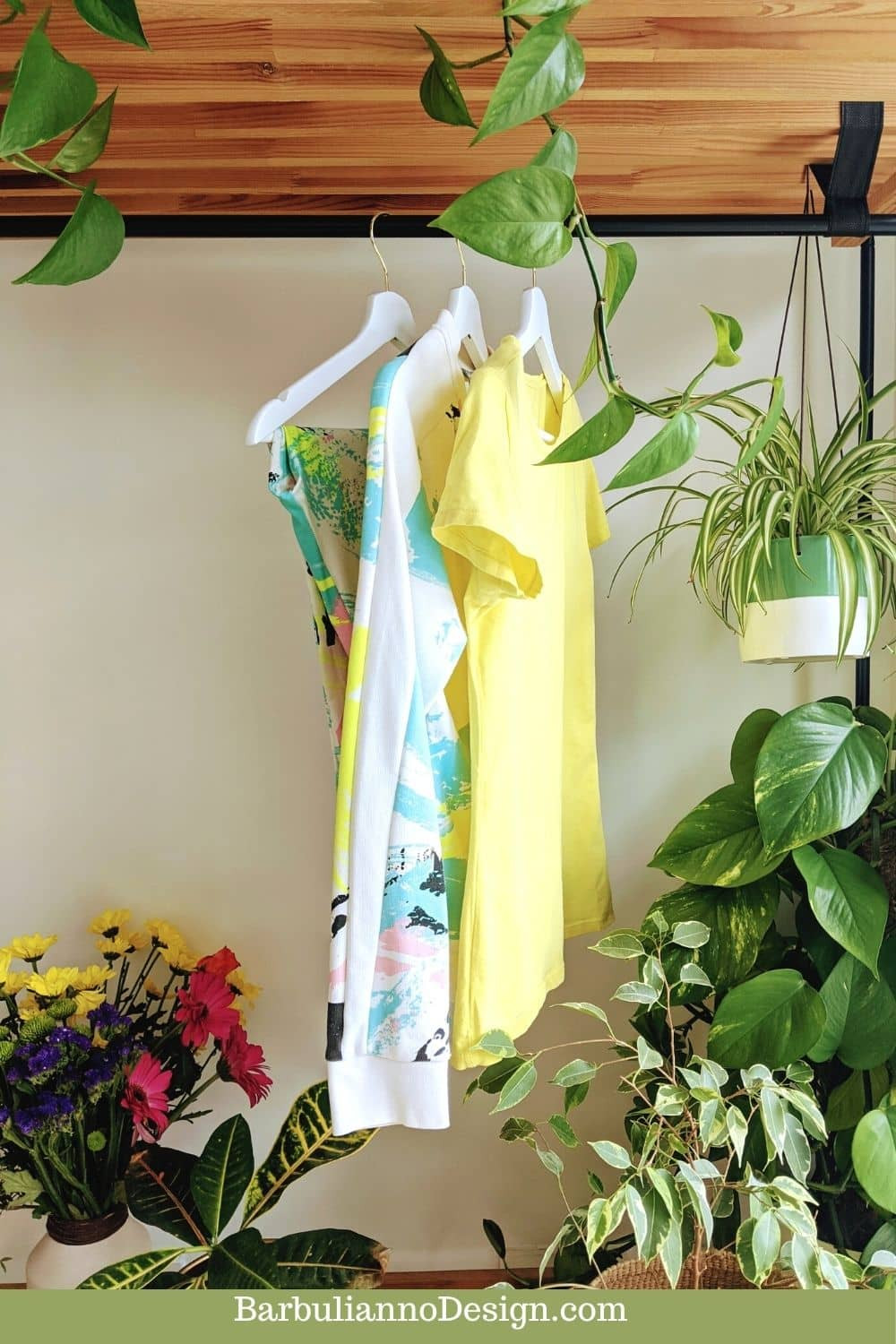 Cohesive sustainable open style wardrobe, with yellow clothes,  decorated with plants and matching flowers.