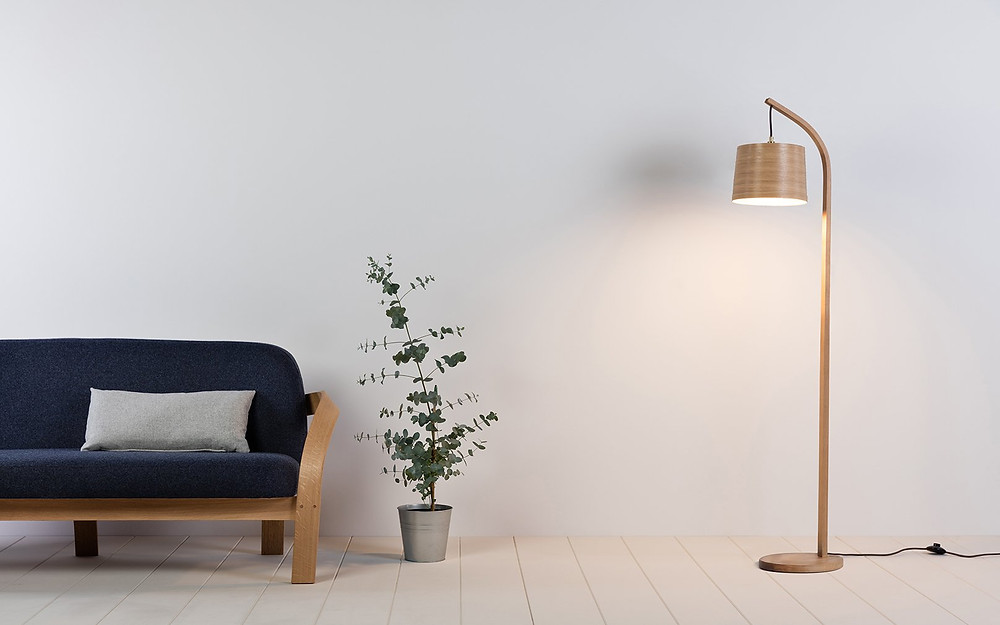 Sustainably sourced oak floor lamp, perfect for autumn inspired living room design.