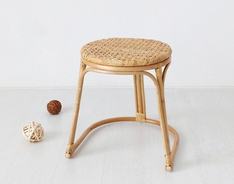 natural rattan stool as a bathroom plant holder