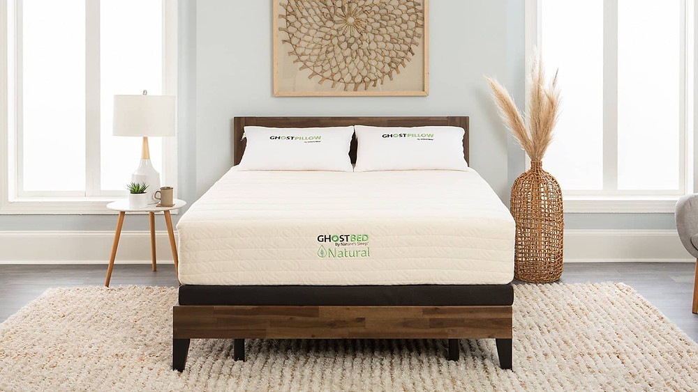 natural eco-friendly mattress in white with eco-friendly pillows, on a dark wood bed frame
