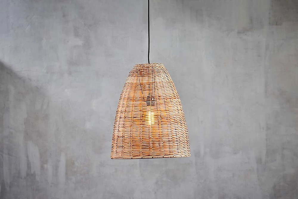 Natural rattan pendant as biophilic office furniture