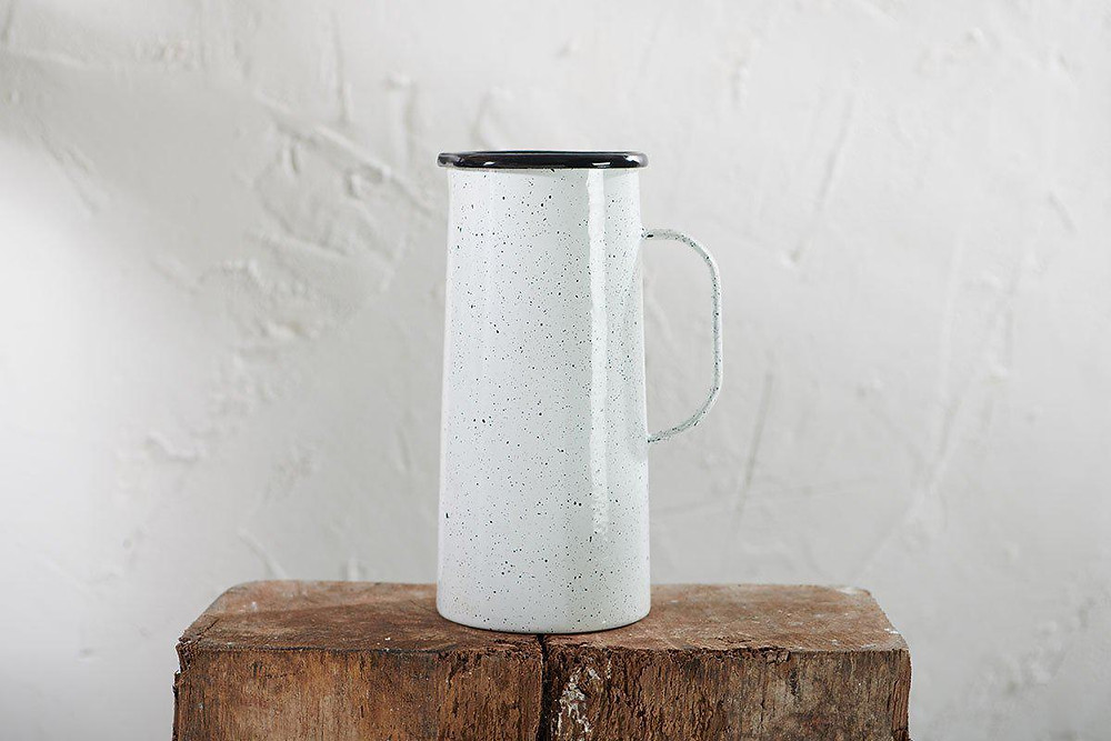 Tall white jug with black speckles