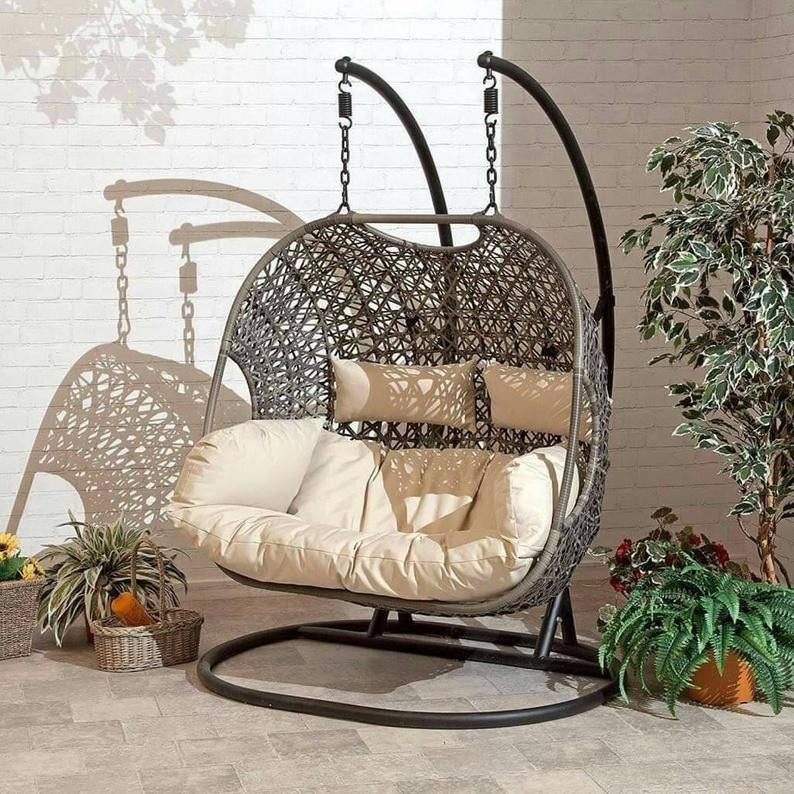 hanging chair with stand made of cane - eco friendly material.