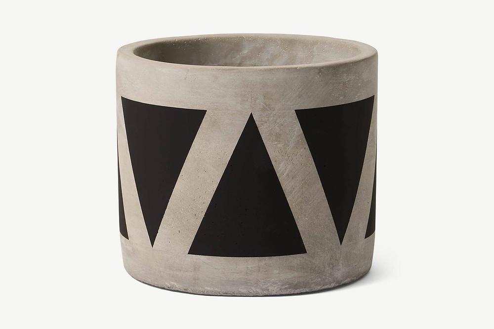 Concrete pot in with black triangles print. Click on the image to shop the planter on made.com