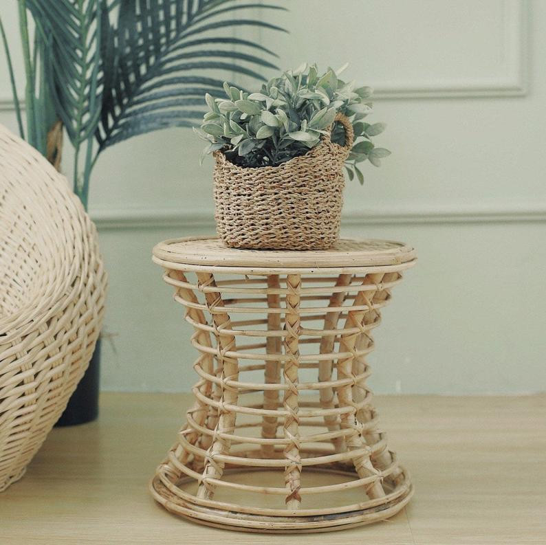 natural rattan stool as a bathroom plant holder