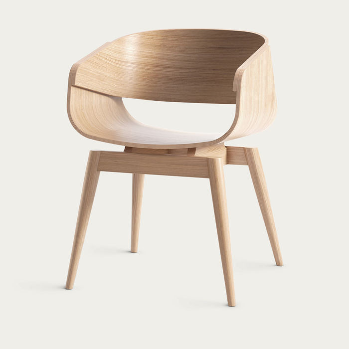 Sustainably made armchair in light wood.
