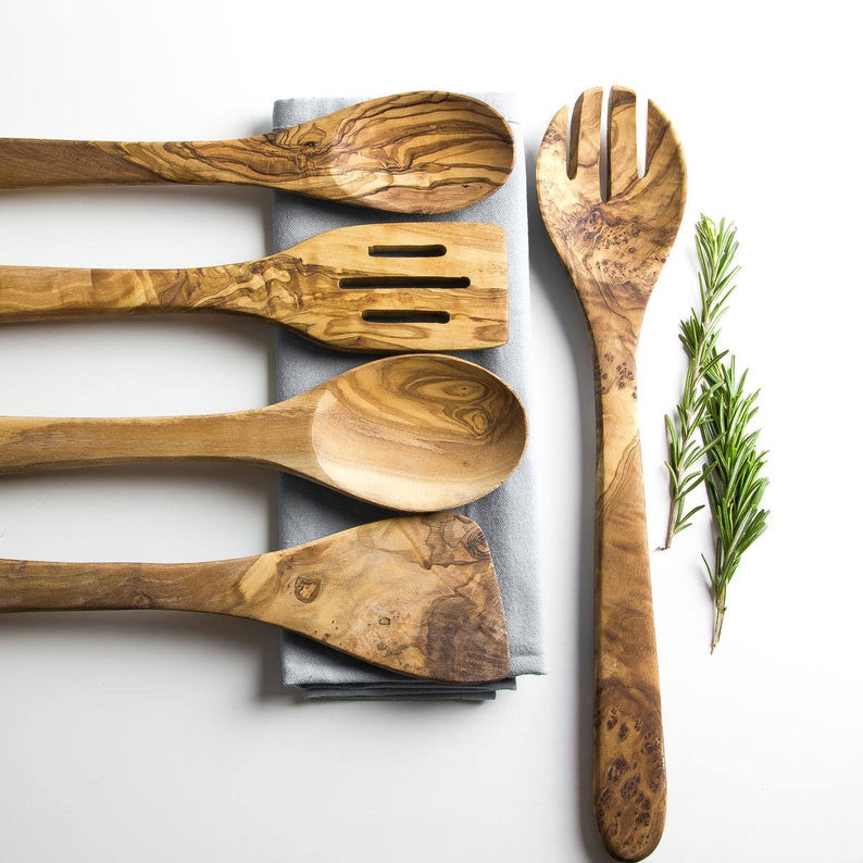 Sustainable wooden utensil set made from very old olive trees, beautifully arranged next to each other.  To get yours click on the image and it will take you to Etsy shop called Rustic Flitch.