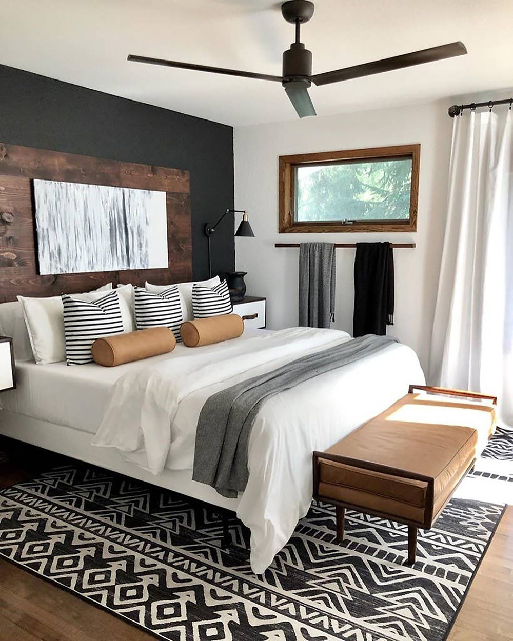 Black accent wall in bedroom design