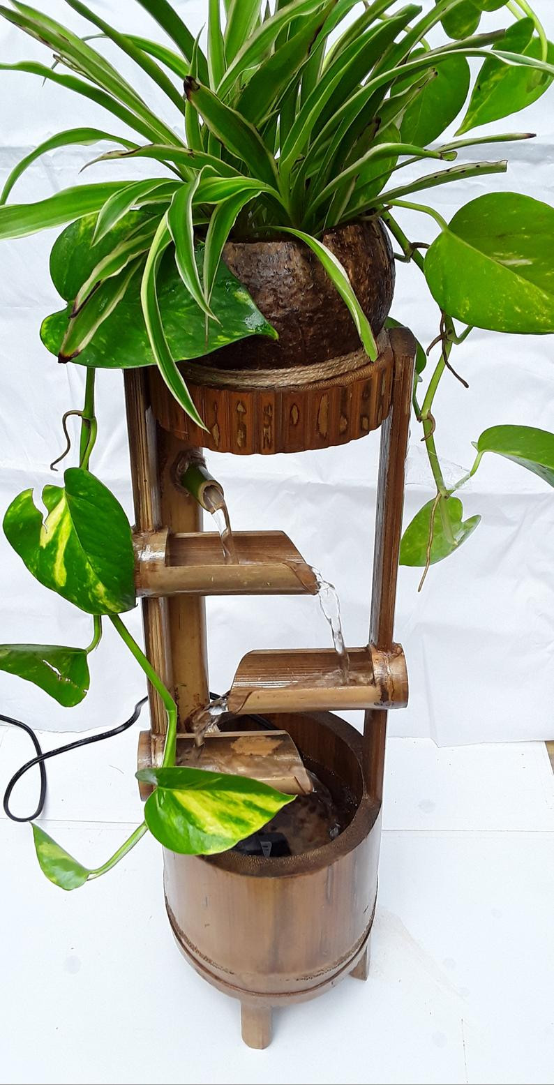 Indoor fountain as a Biophilic decorative piece.