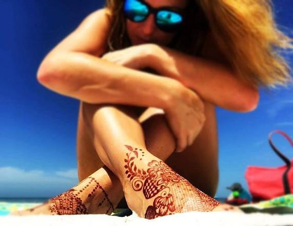 Beautiful girl chillin at the beach enjoying her henna...jpg