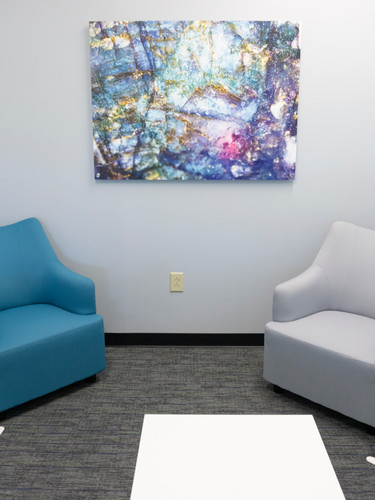The huddle rooms are great for collaborating with a team and the Bedrock art image keeps with the neutral yet inspiring tones and colors.