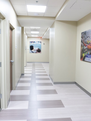 Hallway to various conference rooms available for meetings at United Way of the Midlands. Art images are printed with UV cured inks on clear acrylic.