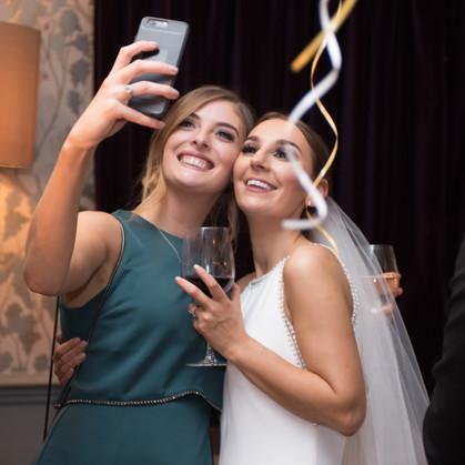 bride and bridesmaid selfies