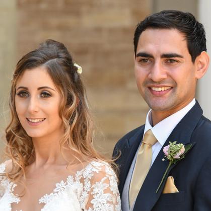 Happy couple posing for wedding photos