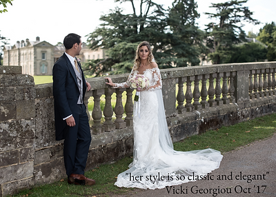 Married couple posing for theiphotos at Compton Verney Stately home on the bridge weddng
