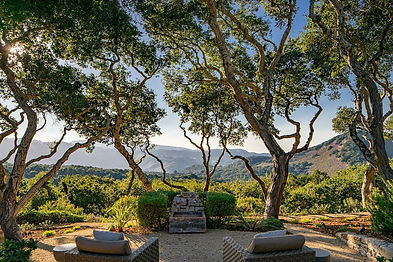Perfectly situated on an oak-studded knoll overlooking the Potrero Canyon, this Elegant Country home embraces mountain and valley views, filtered sun rays, and is just 8 minutes from the Preserve gate. The comfortable floor plan is perfectly set up for a couple, with two offices off the master, yet scales well for guests with two additional ground-level suites off the family room. Tall ceilings with expansive windows bring the serenity of nature in, with French doors opening to the outdoor dining room with a fireplace, a large seating area with a fire pit overlooking the valley below, and even a rope swing for the young-at-heart to enjoy. Enjoy the sun and privacy of the valley next to the swimming pool after a hike on one of the many Santa Lucia Preserve trails.
