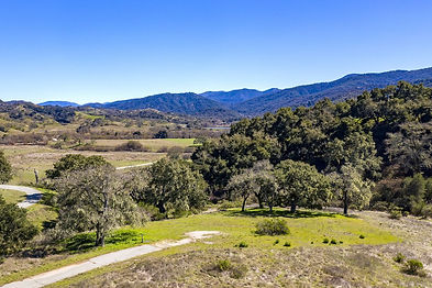 Located inside the private gates of the Santa Lucia Preserve and just short walk to the Ranch Club's social heartbeat, this flat 7.92-acre lot with a 0.43-acre building envelope basks in year-round sun. It's distant ridgeline and savanna views and close proximity to the Hacienda, Sports Center, and Equestrian Center make this location most desirable.