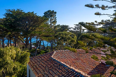 Capturing the essence of Pebble Beach, this 1920's estate offers the best combination of views, privacy, and proximity to The Lodge. Renovated in 2017, this 4 bedroom house boasts ocean views from the main living areas with vaulted ceilings, a classic wood burning fireplace, and authentic hardwood floors all over looking the ocean-facing deck. Just off the living area and deck, the intimate dining room looks to the Pacific and across the oak trees and grounds, setting the perfect scene to share long evenings with friends. The master bedroom, located on the main level, is surrounded by the serenity of native trees and lush gardens. A separate one bedroom guest house just off the main house is perfect for guests looking for a little more privacy. All this sited on a 2.3 acre corner lot along the famed 17 Mile Drive and just down the street from The Lodge.