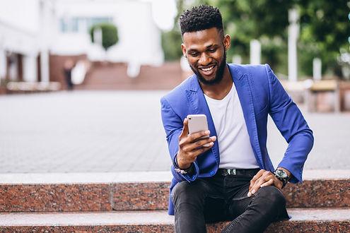 african-american-man-blue-jacket-using-p
