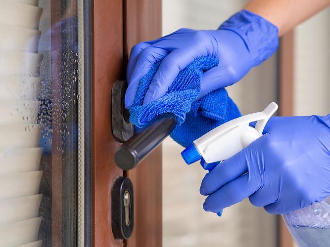 hands-disinfecting-door-handle-with-ablu