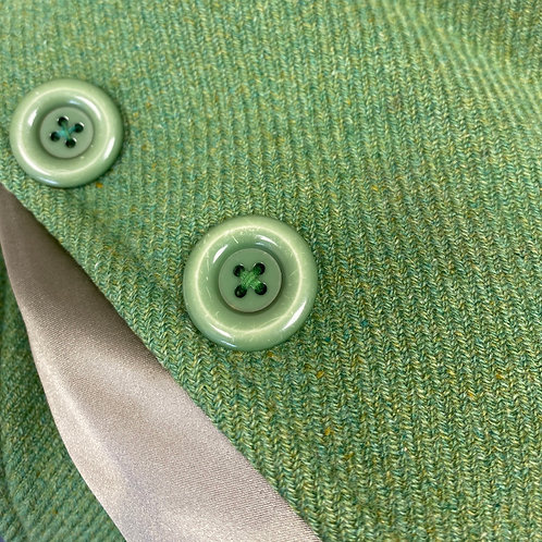 Sew button back on