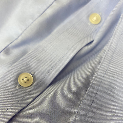 Sew shirt button back on