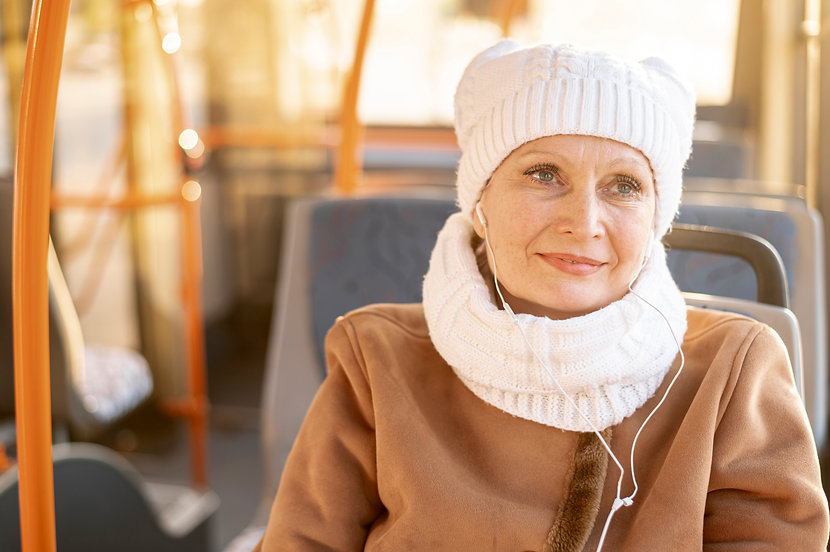 elder-woman-in-bus-listening-music.jpg