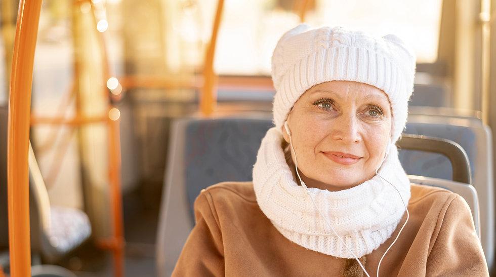 elder-woman-in-bus-listening-music_edite