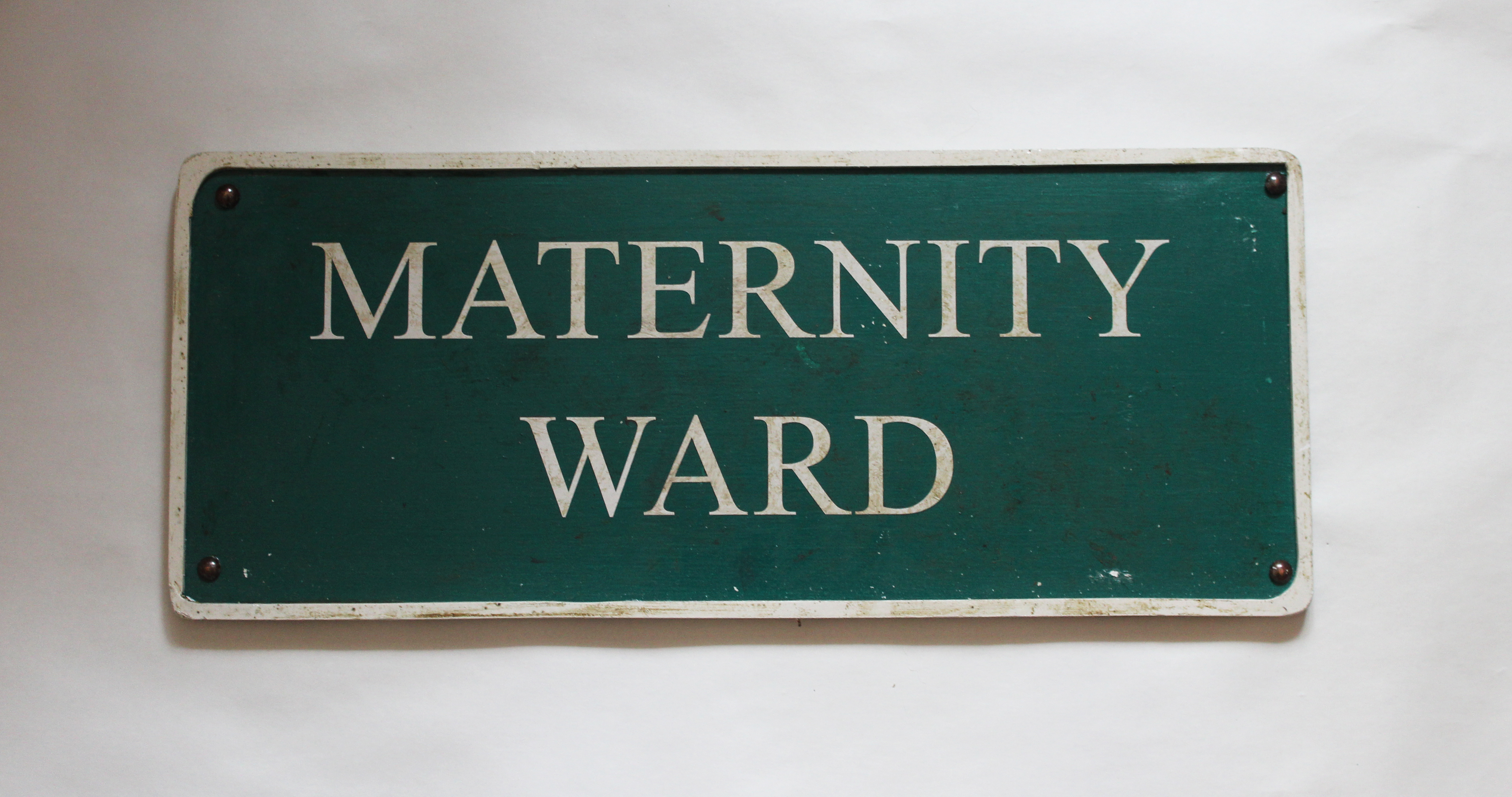 Int. Maternity Ward 1930s dreamscape signage