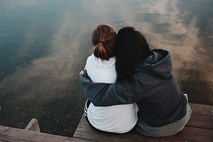 two people hugging each other