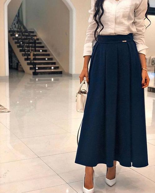 White shirt with navy skirt