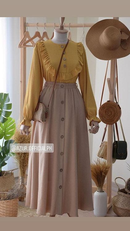 Yellow shirt with beige skirt