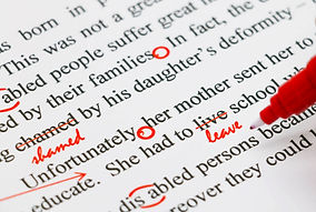 closeup red marks on proofreading englis