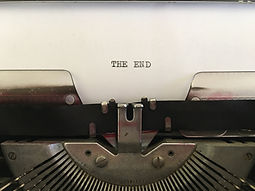 The End; black text typed on white paper